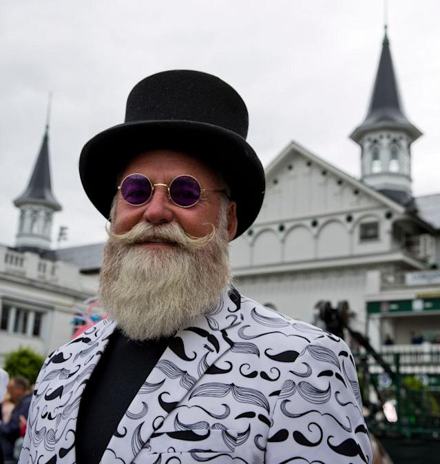 <p>A man sports both a well-groomed beard and a mustache-themed coat. (Photo: Getty Images) </p>