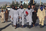 In this Tuesday, May 26, 2020 file photo, Afghan Taliban prisoners freed from Bagram prison walk in Kabul, Afghanistan. TAfghanistan has been at war for more than 40 years, first against the invading Soviet army that killed more than 1 million people, then feuding mujahedin groups in a bitter civil war followed by the repressive Taliban rule and finally the latest war that began after the 2001 U.S.-led coalition invasion that toppled the Taliban government. (AP Photo/ Rahmat Gul, File)