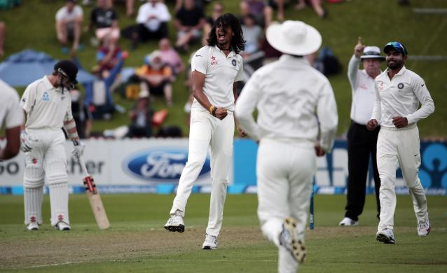 India's Ishant Sharma (2nd L) celebrates the dismissal of New Zealan's Peter Fulton during day one of the second international test cricket match at the Basin Reserve in Wellington, February 14, 2014. REUTERS/Anthony Phelps (NEW ZEALAND - Tags: SPORT CRICKET)