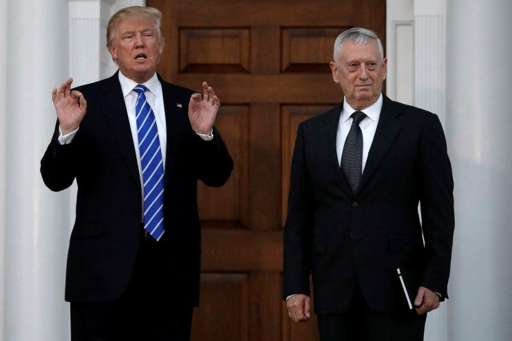 Donald Trump stands with retired Marine Gen. James Mattis following their meeting at the main clubhouse at Trump National Golf Club in Bedminster, N.J. (Photo: Mike Segar/Reuters)