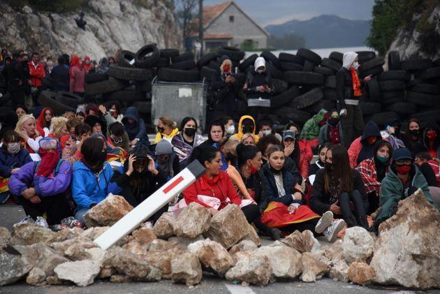 Demonstrators sit at a barricade during a protest against the enthronement of the Serbian Orthodox bishop in Cetinje, Montenegro, 05 September 2021. The enthronement of the new bishop of the Serbian Orthodox Church in Montenegro is causing a divide in Montenegro, sparking tensions between the members of the Serbian orthodox church and protestors who are opposing the ceremony taking place in the former Montenegrin royal capital.  EPA/BORIS PEJOVIC (Photo: BORIS PEJOVIC EPA)