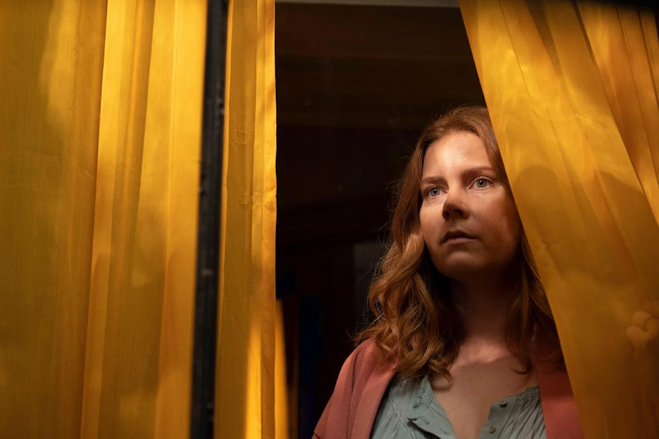 """Amy Adams plays an agoraphobic psychologist who witnesses a bloody scene from across the street in the twisty thriller """"The Woman in the Window."""""""