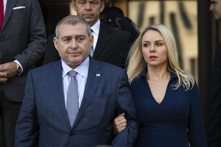 Images shows Lev Parnas (L) and his wife Svetlana Parnas leaving Manhattan federal court in New York City after a criminal arraignment on October 23, 2019.  (Photo by Drew Angerer/Getty Images) ORG XMIT: 775423222 ORIG FILE ID: 1177748124