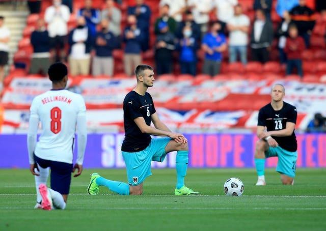 England and Austria players take a knee at the Riverside on Wednesday (Lindsey Parnaby/PA).