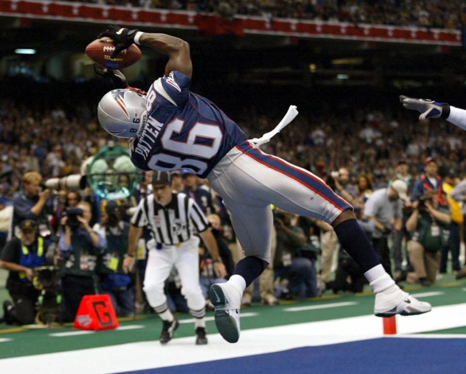 FILE - In this Feb. 3, 2002, file photo, New England Patriots wide receiver David Patten grabs a touchdown pass during the second quarter of Super Bowl XXXVI against the St. Louis Rams at the Louisiana Superdome in New Orleans, La. Patten, who caught Tom Brady's first postseason touchdown to help the Patriots win their first Super Bowl, was killed in a motorcycle accident on Thursday night, Sept. 3, 2021, outside of Columbia, S.C., Richard County coroner Naida Rutherford said in a statement. He was 47. Patten played 12 seasons in the NFL after signing as an undrafted free agent with the New York Giants in 1997. (J.B. Forbes/St. Louis Post-Dispatch via AP, File)