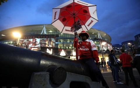 An Arsenal fan with an umbrella. An umbrella! - Credit: Charlotte Wilson/Offside/Getty Images