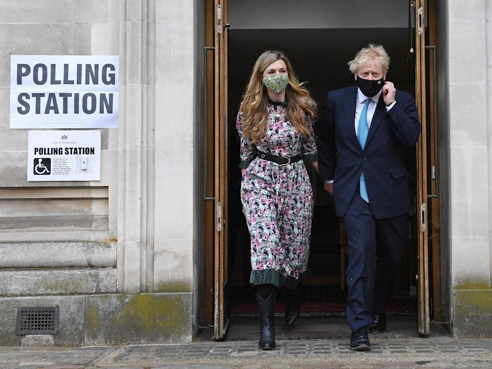 Carrie Symonds with Boris Johnson outside polling stationPA