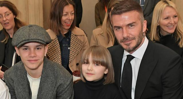 Harper Beckham nails summer dressing in orange checked dress from Uniqlo - and it's under £15. (Getty Images)