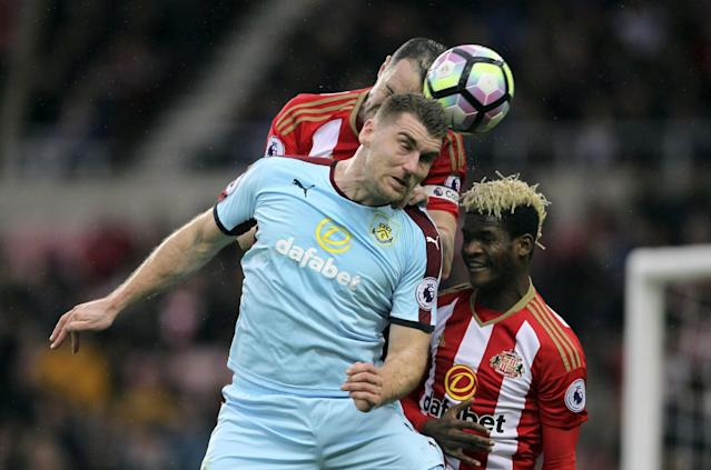 <p>Burnley's Sam Vokes jumps for the ball during the English Premier League soccer match between Sunderland and Burnley </p>