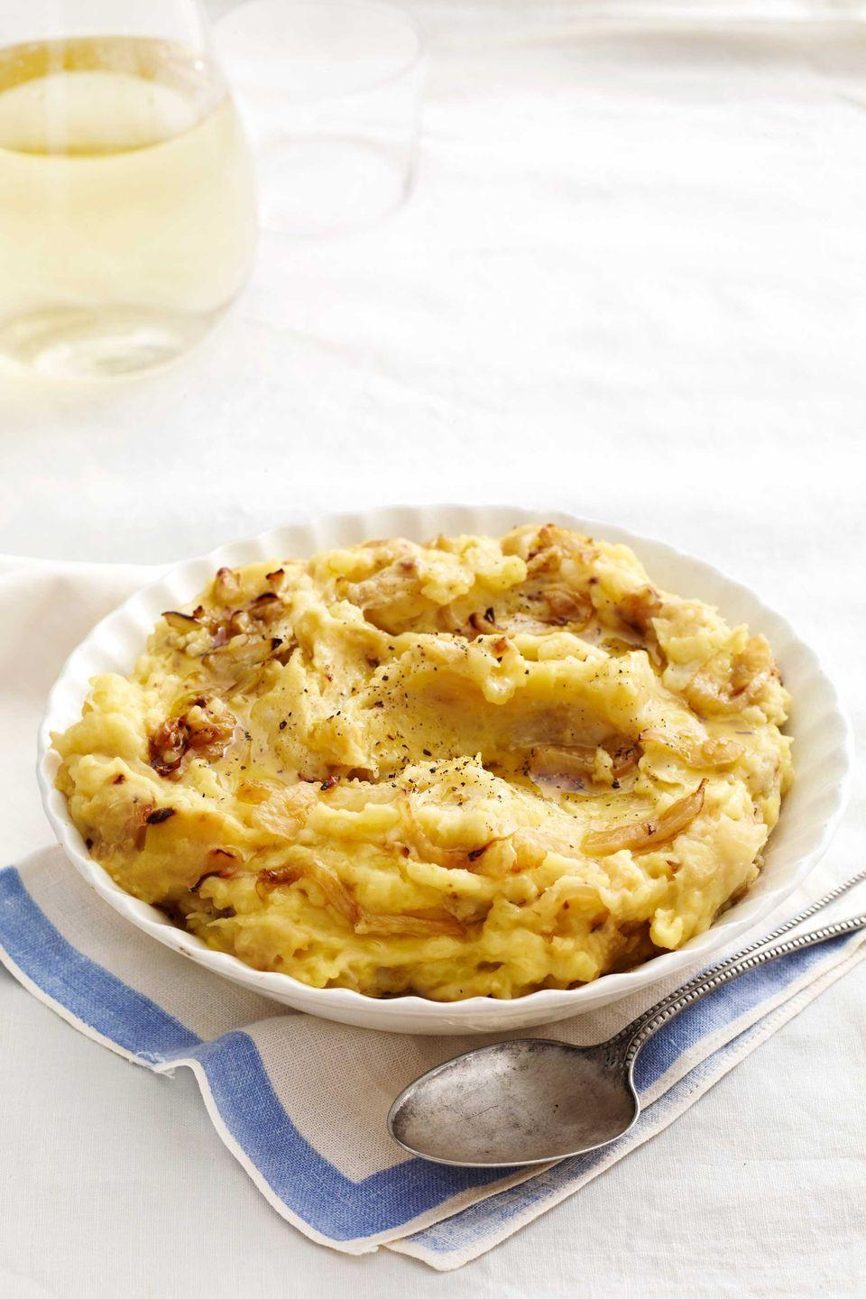 "<p>Caramelized fennel adds a flavor and color to these creamy mashed potatoes.</p><p><strong><a href=""https://www.countryliving.com/food-drinks/recipes/a4954/mashed-potatoes-caramelized-fennel-recipe-clx0414/"" rel=""nofollow noopener"" target=""_blank"" data-ylk=""slk:Get the recipe"" class=""link rapid-noclick-resp"">Get the recipe</a>.</strong></p>"