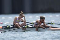 Marieke Keijser and Ilse Paulis, of Netherlands react after competing in the lightweight women's rowing double sculls final at the 2020 Summer Olympics, Thursday, July 29, 2021, in Tokyo, Japan. (AP Photo/Lee Jin-man)
