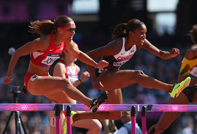 LONDON, ENGLAND - AUGUST 06: Lolo Jones of the United States jumps over a hurdle alongside Phylicia George of Canada in the Women's 100m Hurdles heat on Day 10 of the London 2012 Olympic Games at the Olympic Stadium on August 6, 2012 in London, England. (Photo by Hannah Johnston/Getty Images)