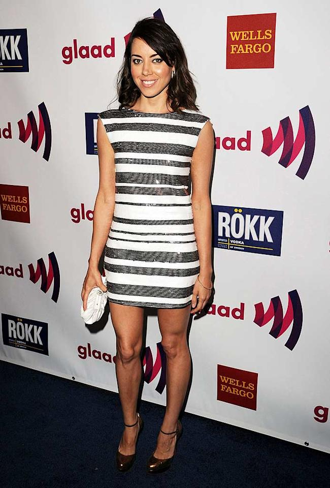 """Following in Marlee's footsteps was our favorite """"Parks and Recreation"""" co-star (sorry, Aziz Ansari), Aubrey Plaza, who looked sensational in a white-and-silver-striped dress, bronze ankle-strap heels, and muted makeup. Jason Merritt/<a href=""""http://www.wireimage.com"""" target=""""new"""">WireImage.com</a> - April 10, 2011"""