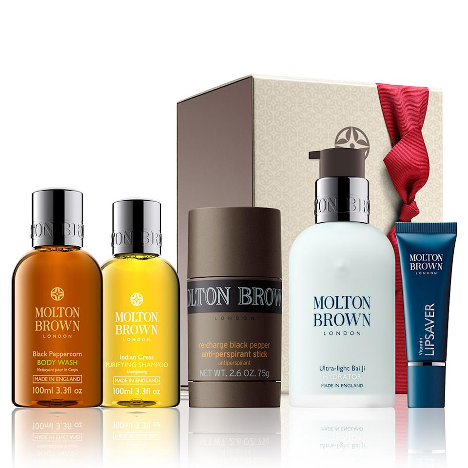 """<p>For fathers who work out on Christmas Day — or want to get rid of their dad bod in the new year — this set of gym toiletries will make exercising so much more enjoyable. <b><a href=""""http://www.moltonbrown.com/store/mens/mens-gym-bag-essentials/ultimate-gym-essentials-gift-set/WBB196/"""">Molton Brown Ultimate Gym Essentials Gift Set</a> ($106)</b></p>"""