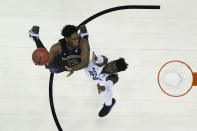 <p>Noah Dickerson #15 of the Washington Huskies shoots over Neemias Queta #23 of the Utah State Aggies in the first round of the 2019 NCAA Men's Basketball Tournament held at Nationwide Arena on March 22, 2019 in Columbus, Ohio. </p>
