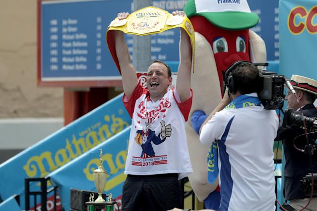<p>Joey Chestnut wins the annual Nathan's Hot Dog Eating Contest, setting a new world record by eating 74 hot dogs in Brooklyn, New York City, U.S., July 4, 2018. (Photo: Stephen Yang/Reuters) </p>