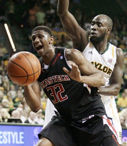 Texas Tech 's Jordan Tolbert (32) loses control of the ball under pressure from Baylor 's Quincy Acy, right, in the first half of an NCAA college basketball game Monday, Feb. 27, 2012, in Waco, Texas. (AP Photo/Tony Gutierrez)