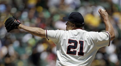 Oakland Athletics' Bartolo Colon works against the Seattle Mariners in the first inning of a baseball game, Sunday, July 8, 2012, in Oakland, Calif. (AP Photo/Ben Margot)