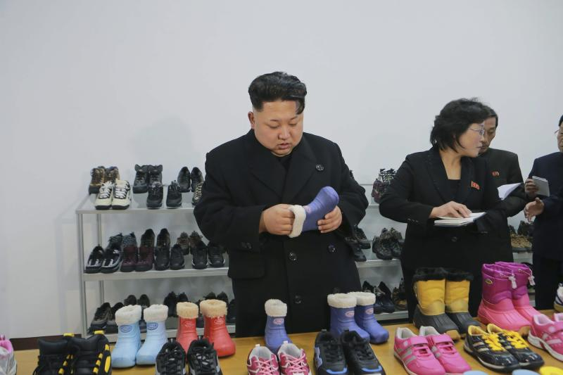 North Korean leader Kim provides field guidance to the Ryuwon Shoes Factory in this undated photo released by North Korea's KCNA in Pyongyang