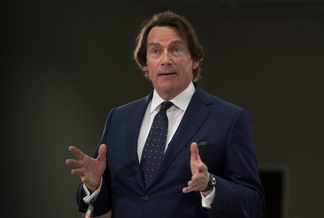Peladeau buying Montreal taxi firm, including insolvent electric taxi company
