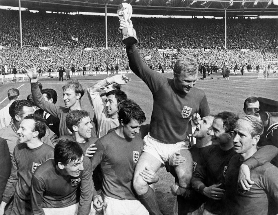 England's Nobby Stiles, Martin Peters, Jack Charlton, Alan Ball, Gordon Banks, Geoff Hurst, Bobby Moore (captain, holds aloft the World Cup (Jules Rimet Trophy). Ray Wilson, George Cohen and Bobby Charlton celebrate victory. (Photo by S&G/PA Images via Getty Images)