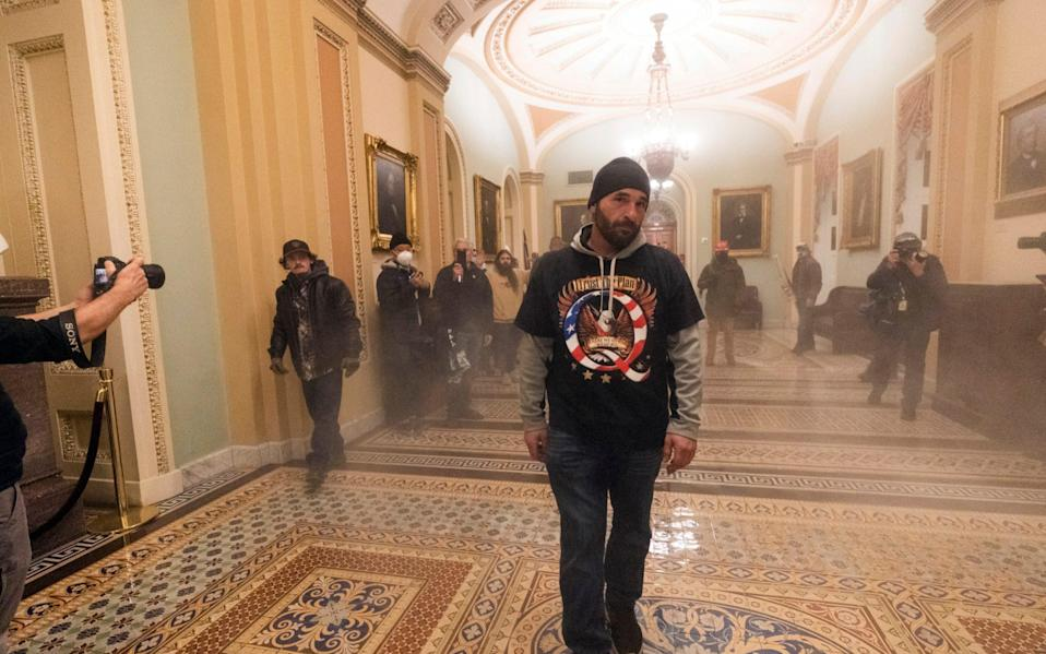 Donald Trump's supporters stormed the US Capitol earlier this month  - Manuel Balce Ceneta/AP