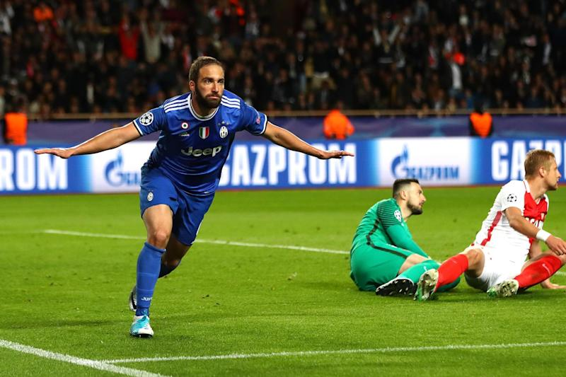 Double delight: Higuain celebrates his second at the Stade Louis II: Getty Images