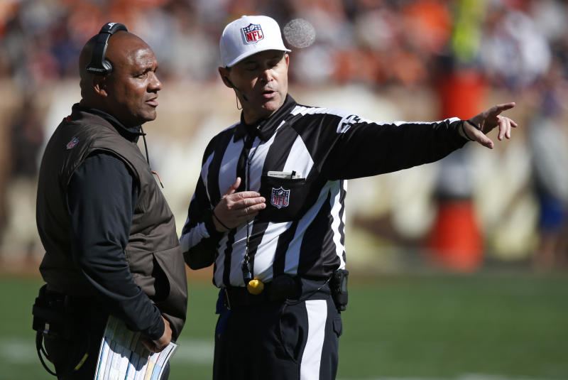 Cleveland Browns head coach Hue Jackson, left, talks with referee Brad Allen in the first half during an NFL football game against the Los Angeles Chargers, Sunday, Oct. 14, 2018, in Cleveland. (AP Photo/Ron Schwane)