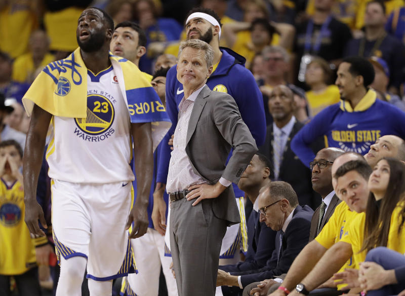 Golden State Warriors head coach Steve Kerr, center, watches during the first half of Game 3 of the NBA basketball Western Conference Finals against the Houston Rockets in Oakland, Calif., Sunday, May 20, 2018. (AP Photo/Marcio Jose Sanchez)