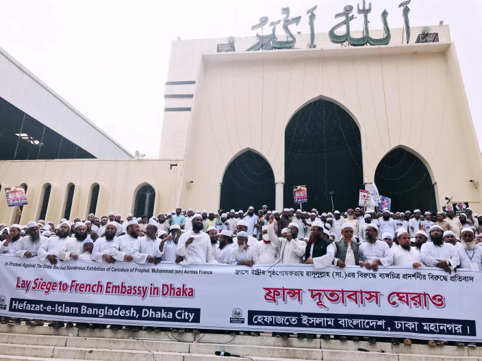 Thousands of Muslims protesting the French president's support of secular laws allowing caricatures of the Prophet Muhammad gather in Dhaka, Bangladesh, Monday, Nov.2, 2020. (AP Photo/Al-emrun Garjon)