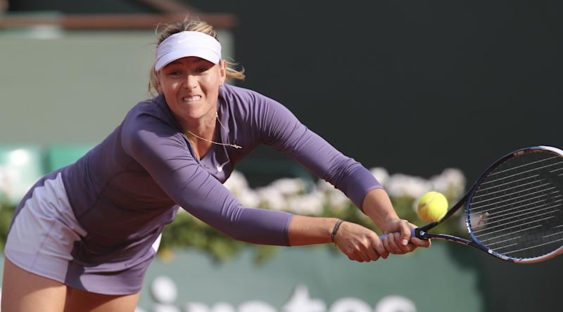 Russia's Maria Sharapova returns against Sloane Stephens of the U.S.  in their fourth round match at the French Open tennis tournament, at Roland Garros stadium in Paris, Monday June 3, 2013. (AP Photo/Michel Euler)