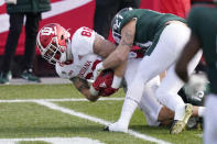 Indiana tight end Peyton Hendershot (86) is tackled by Michigan State linebacker Chase Kline (21) during the first half of an NCAA college football game, Saturday, Nov. 14, 2020, in East Lansing, Mich. (AP Photo/Carlos Osorio)