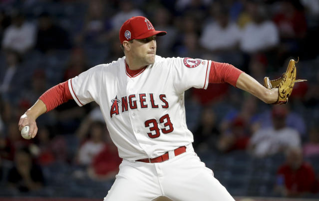 Los Angeles Angels relief pitcher Jim Johnson throws against the Texas Rangers during the first inning of a baseball game in Anaheim, Calif., Tuesday, Sept. 11, 2018. (AP Photo/Chris Carlson)