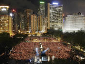 FILE - In this June 4, 2007, file photo, thousands of people attend a candlelight vigil in Hong Kong's Victoria Park to mark the anniversary of the military crackdown on a pro-democracy student movement in Beijing as Hong Kong marks the 10th anniversary of its handover from British to Chinese rule on July 1, 2007. (AP Photo/Vincent Yu, File)