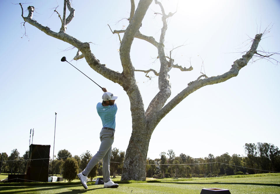 Max Homa tees off on the third hole during the final round of the Genesis Invitational golf tournament at Riviera Country Club, Sunday, Feb. 21, 2021, in the Pacific Palisades area of Los Angeles. (AP Photo/Ryan Kang)