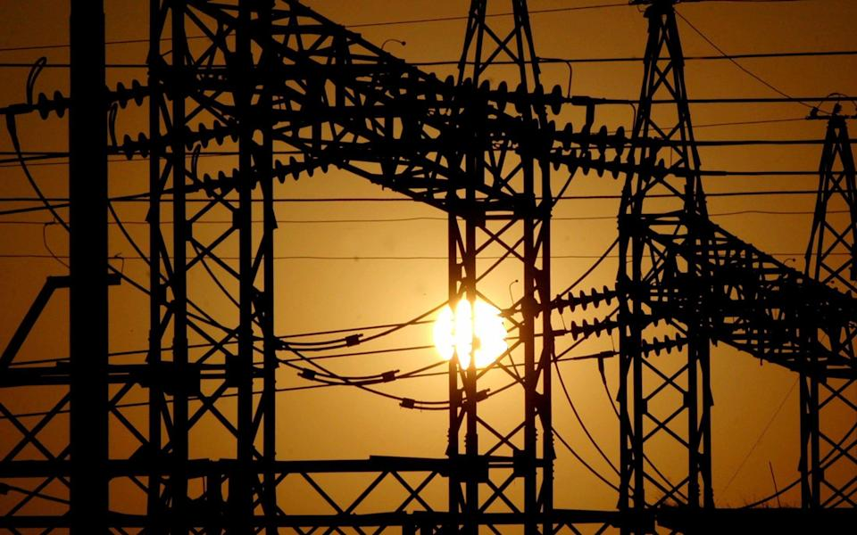 Sun sets behind electric pylons in Allahabad...The sun sets behind electric pylons in the northern Indian city of Allahabad February 22, 2006.