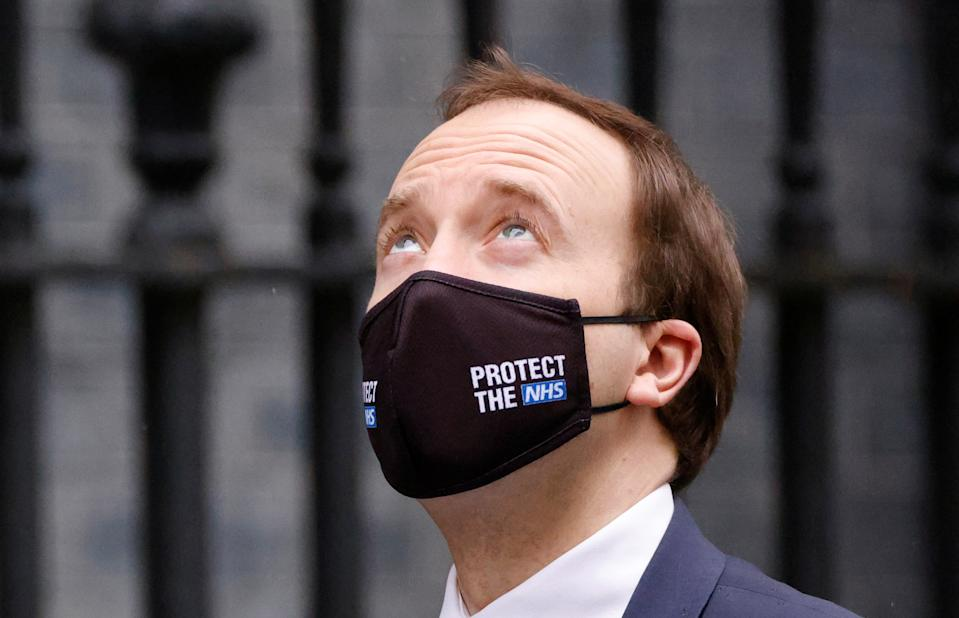 British Health Secretary Matt Hancock walks outside Downing Street in London, Britain, March 10, 2021. REUTERS/John Sibley