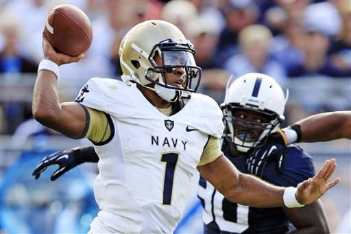 Navy quarterback Trey Miller (1) passes under pressure from Penn State defensive end Sean Stanley (90) during the second quarter of an NCAA college football game in State College, Pa., Saturday, Sept. 15, 2012. (AP Photo/Gene J. Puskar)