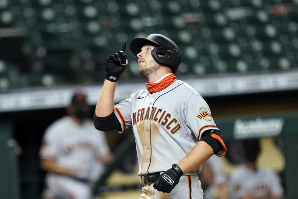 San Francisco Giants' Austin Slater celebrates after hitting a home run against the Houston Astros during the eighth inning of a baseball game Monday, Aug. 10, 2020, in Houston. (AP Photo/David J. Phillip)