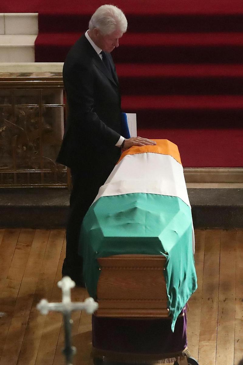 Tribute: Former US President Bill Clinton touches the coffin (PA)