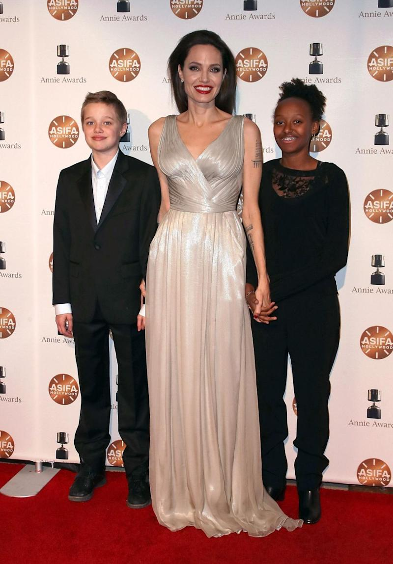 (L-R) Shiloh Nouvel Jolie-Pitt, actress Angelina Jolie and Zahara Marley Jolie-Pitt attend the 45th Annual Annie Awards at Royce Hall on February 3, 2018 in Los Angeles, California. Source: Getty