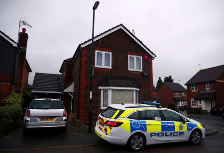 FILE PHOTO: A police car is parked outside a house, after a drone was flown near Gatwick Airport, forcing the airport to close, in Crawley, Britain December 23, 2018. REUTERS/Hannah McKay/File Photo