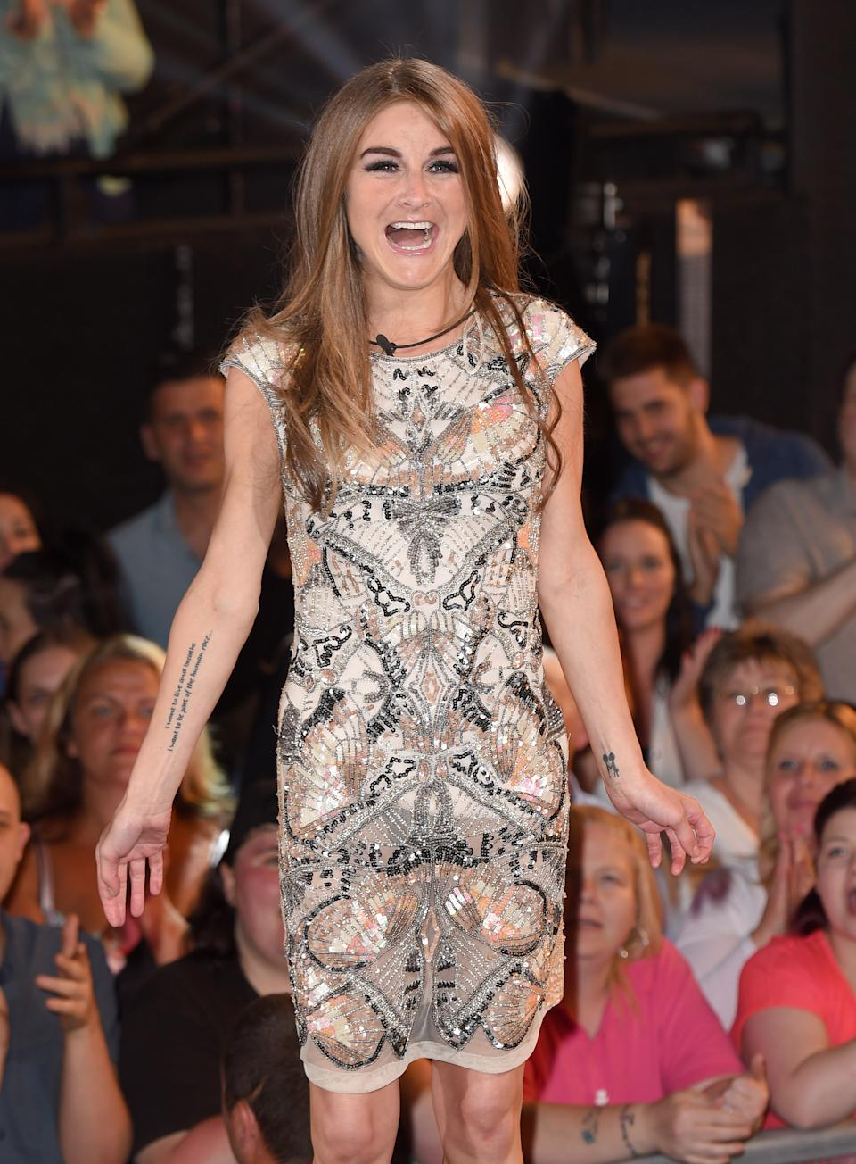 BOREHAMWOOD, ENGLAND - JUNE 12:  Nikki Grahame enters the Big brother house at Elstree Studios on June 12, 2015 in Borehamwood, England.  (Photo by Karwai Tang/WireImage)