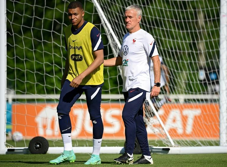 France striker Kylian Mbappe (L) and coach Didier Deschamps (R) prepare for Tuesday's Euro 2020 clash with Germany