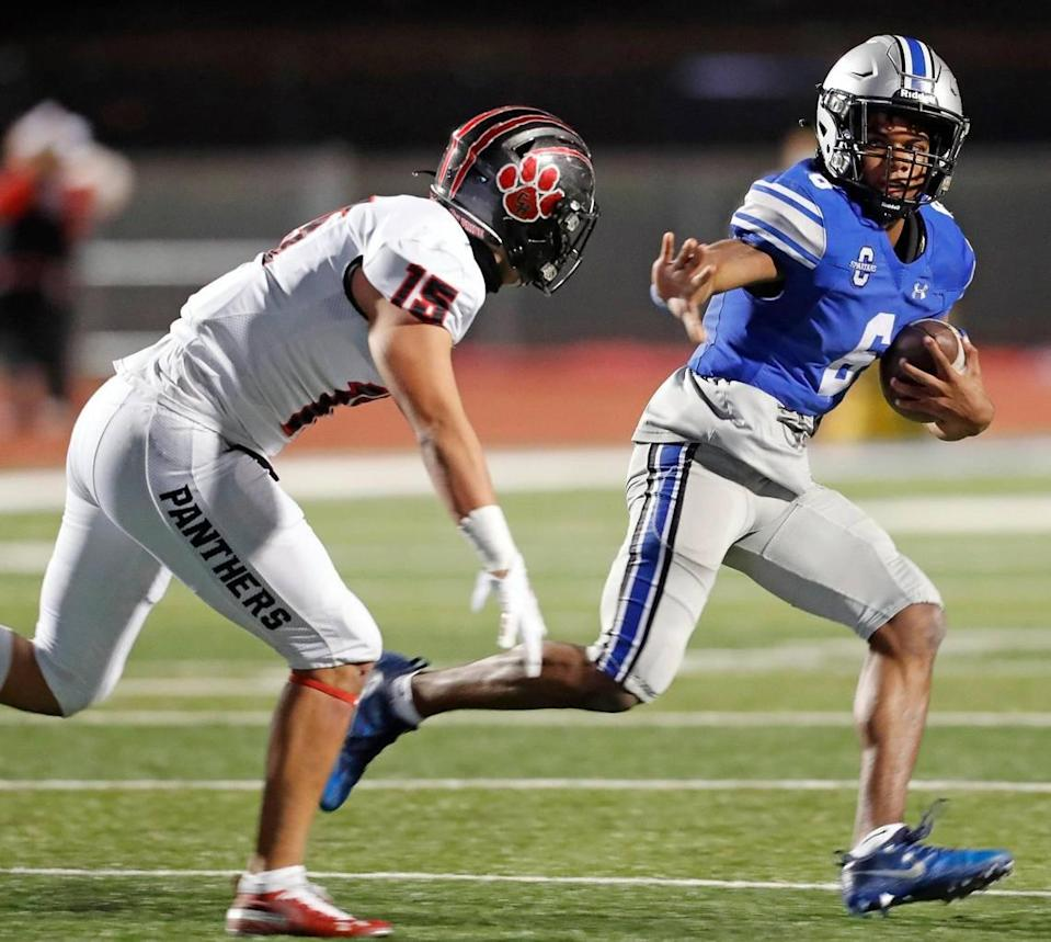 Burleson Centennial quarterback Phillip Hamilton (6) attempts to avoid the tackle of Colleyville Heritage linebacker Chris Knight (15) during a 5A high school football game at Burleson ISD Stadium in Burleson , Texas, Friday, Nov. 27, 2020. Colleyville led 17-0 at the half. (Special to the Star-Telegram Bob Booth)