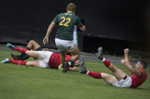 Wales' Ryan Elias (L) scores the winning try against South Africa after Tomos Williams (R) blocked a clearance kick