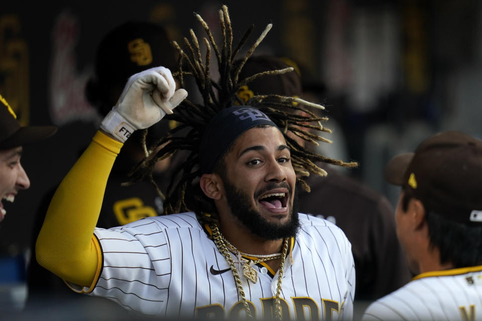 San Diego Padres' Fernando Tatis Jr. reacts in the dugout after hitting a home run during the first inning of a baseball game against the Arizona Diamondbacks, Friday, June 25, 2021, in San Diego. (AP Photo/Gregory Bull)