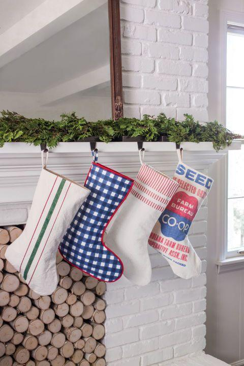 """<p>Add country flair to your mantel with stockings in designs of a <a href=""""https://www.countryliving.com/diy-crafts/g2781/country-christmas-decorations/"""" rel=""""nofollow noopener"""" target=""""_blank"""" data-ylk=""""slk:seed sack, gingham, ticking stripes, or a grain sack"""" class=""""link rapid-noclick-resp"""">seed sack, gingham, ticking stripes, or a grain sack</a>.</p><p><a class=""""link rapid-noclick-resp"""" href=""""https://go.redirectingat.com?id=74968X1596630&url=https%3A%2F%2Fwww.etsy.com%2Fmarket%2Fgrain_sack_stocking&sref=https%3A%2F%2Fwww.countryliving.com%2Fshopping%2Fg1407%2Fpersonalized-christmas-stockings%2F"""" rel=""""nofollow noopener"""" target=""""_blank"""" data-ylk=""""slk:SHOP GRAIN SACK STOCKINGS"""">SHOP GRAIN SACK STOCKINGS</a></p>"""