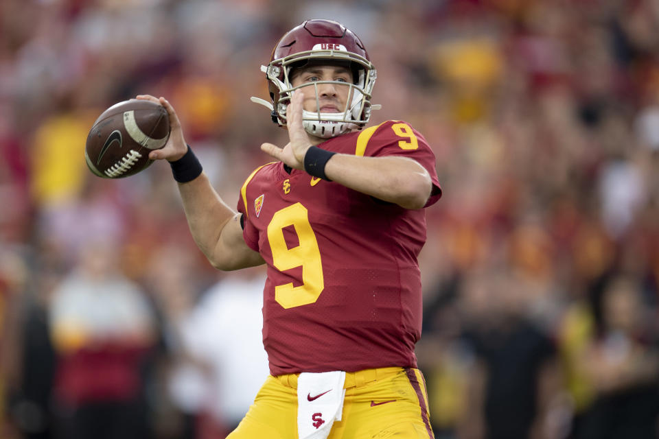 FILE - In this Nov. 2, 2019 file photo, Southern California quarterback Kedon Slovis throws a pass during the first half of an NCAA college football game against Oregon in Los Angeles. Slovis returns s quarterback for his sophomore season in November. (AP Photo/Kyusung Gong, File)