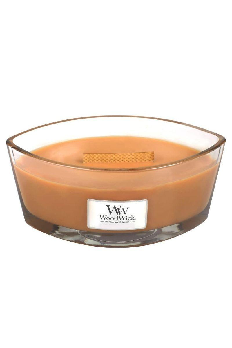 """<p><strong>WoodWick</strong></p><p>amazon.com</p><p><strong>$34.38</strong></p><p><a href=""""https://www.amazon.com/dp/B074HPF1L7?tag=syn-yahoo-20&ascsubtag=%5Bartid%7C10057.g.22998163%5Bsrc%7Cyahoo-us"""" rel=""""nofollow noopener"""" target=""""_blank"""" data-ylk=""""slk:BUY NOW"""" class=""""link rapid-noclick-resp"""">BUY NOW</a></p><p>With its crackling wooden wick, this candle doesn't just smell like the holidays (who can say no to a hot toddy on a cold winter night?), it feels like them too. </p>"""